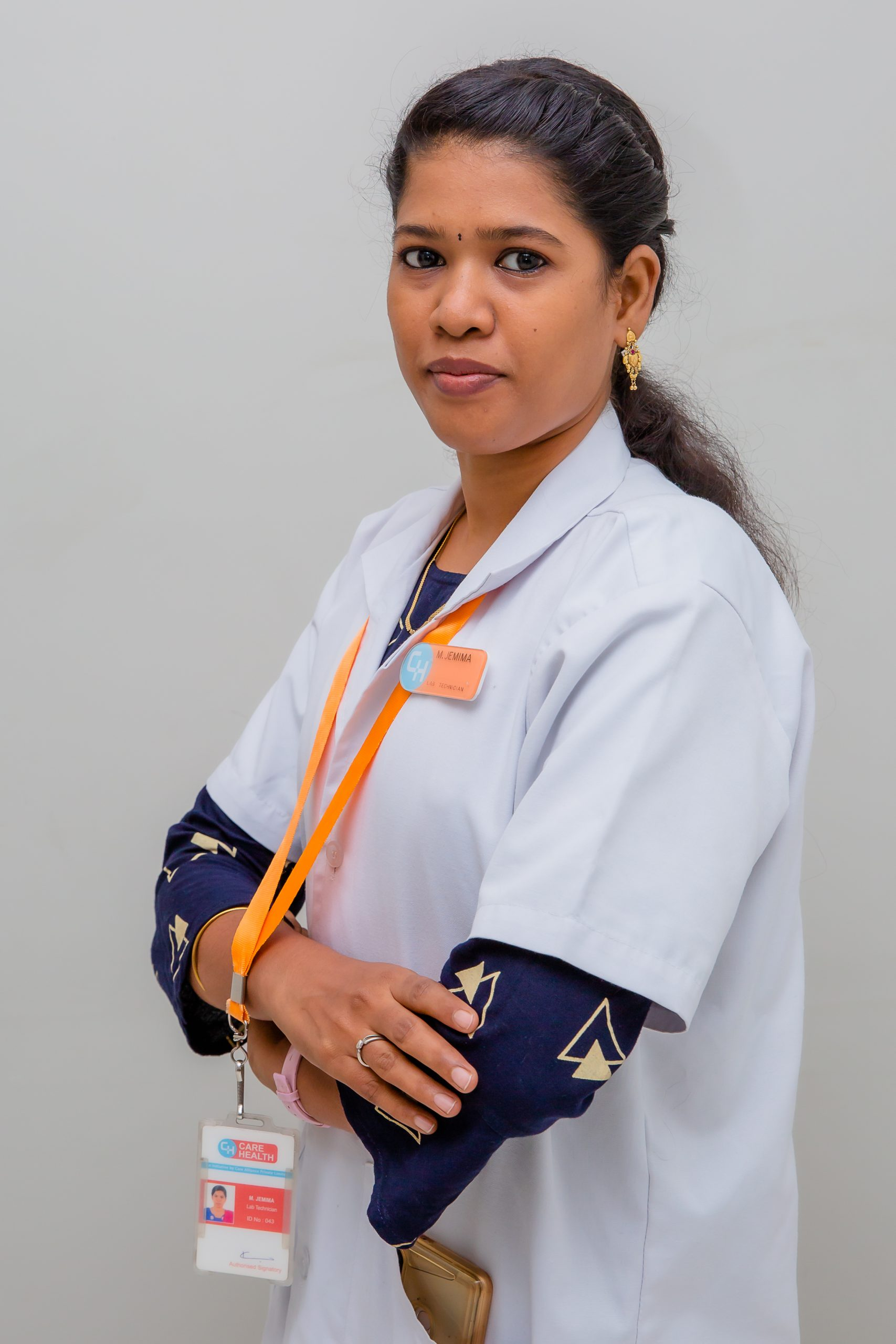 Female lab technician with labcoat and ID badge