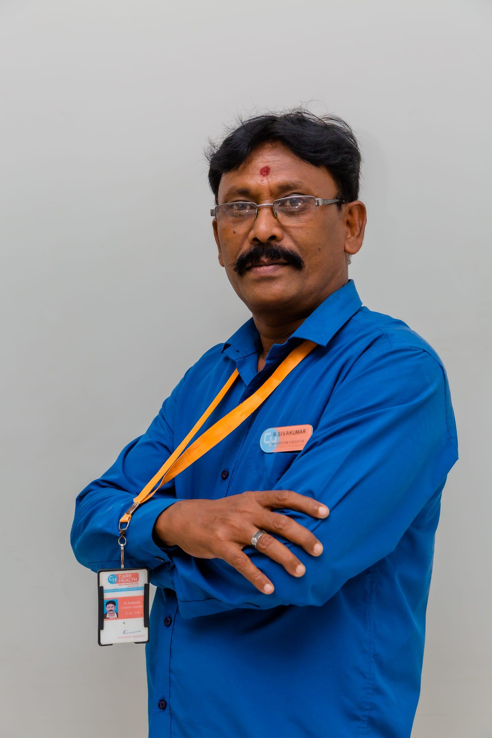Malae staff member wearing blue shirt and ID badge