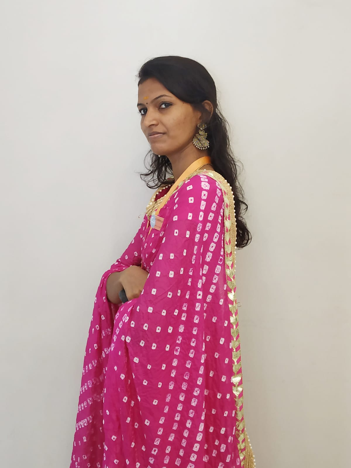 Female accounting staff wearing a pink saree