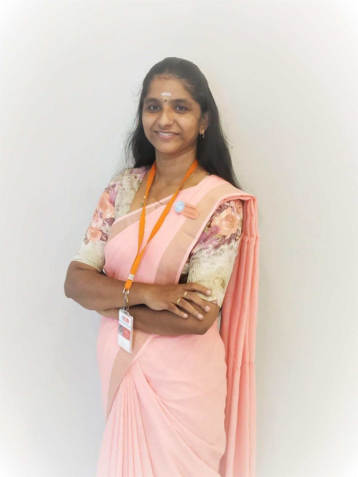 Female staff wearing pink saree